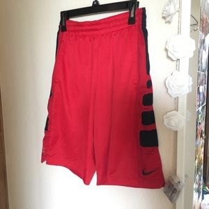 Red and black Nike basketball shorts